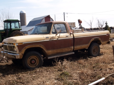 an old 1977 Ford F250 brown and tan pickup