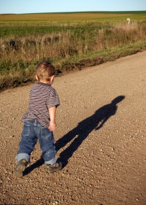 Youngest son running down the gravel road