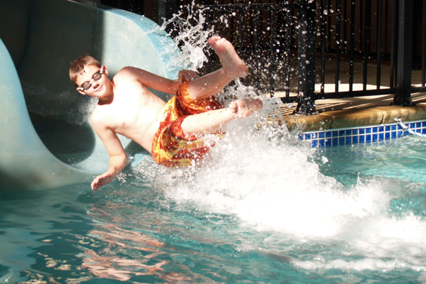 sliding down water slide
