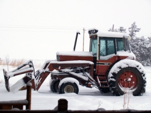 International 1086 tractor sitting in snow on the driveway