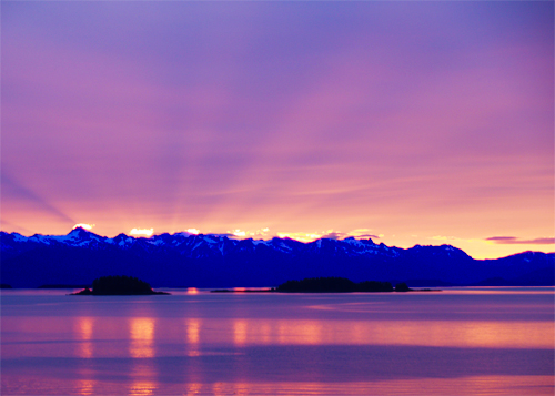 sunset behind the gastineau channel north of juneau, alaska