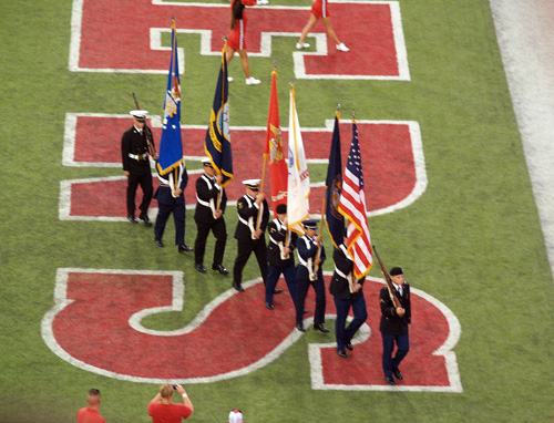 the flag bearers leaving the field at a nebraska cornhusker football game (after the national anthem was sung)