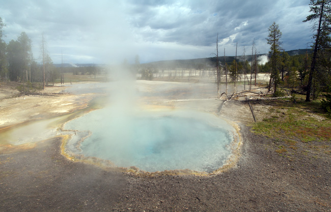 A pool of steamy water at yellowstone national park