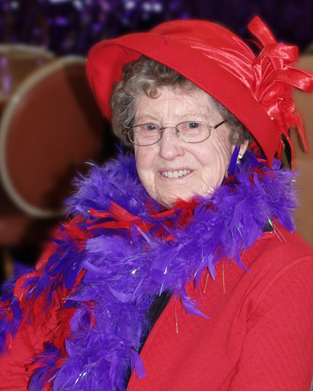 Grandma on her 80th birthday with her red hat and purple boa