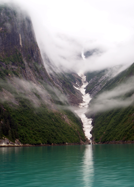 waterfall and mist in tracy arm fjord in southeast alaska