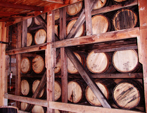 barrels of bourbon aging at a distillery in kentucky