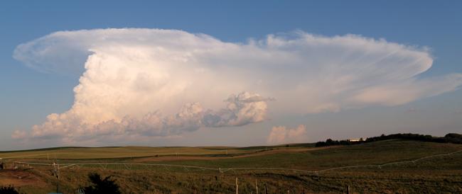 a large, sculptural cloud building into a storm