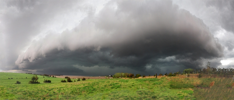 a large storm cloud near a nebraska farm