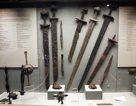 display of viking-era swords at the national history museum in dublin, ireland