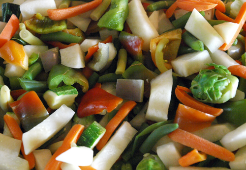 colorful garden vegetables chopped and ready for stir fry