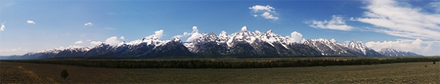panoramic photo of the grand teton mountain range