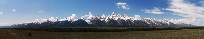 panoramic photo of the grand teton mountain range