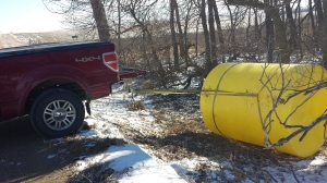 Once found, the tank had to be pulled out of the ditch before we could load it on the trailer.