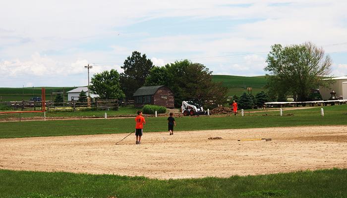 raking debris off the infield