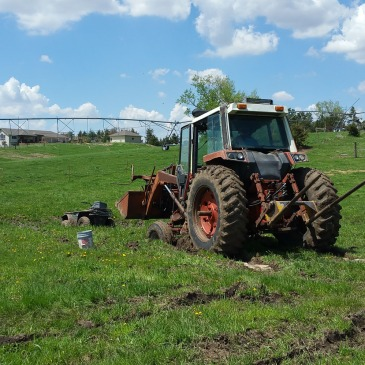 four wheeler and tractor stuck in mud